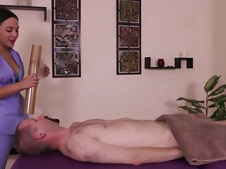 Dominating masseuse jerks off man's cock and doesn't let someone have him cum