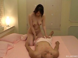 Japanese amateur with natural tits and a hairy pussy rides her husband
