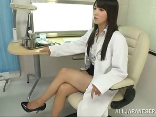 Long haired Asian doctor gives her patient special treatment
